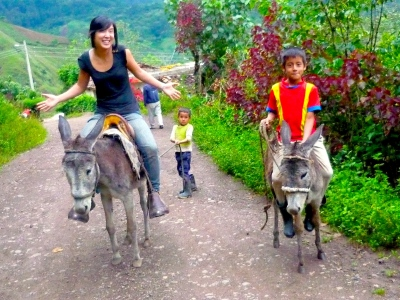 'Cause Missionaries ride donkeys and take photos with ethnic kids ... right? (The lack of a Bible in my hand must make me a bad, weaponless missionary)