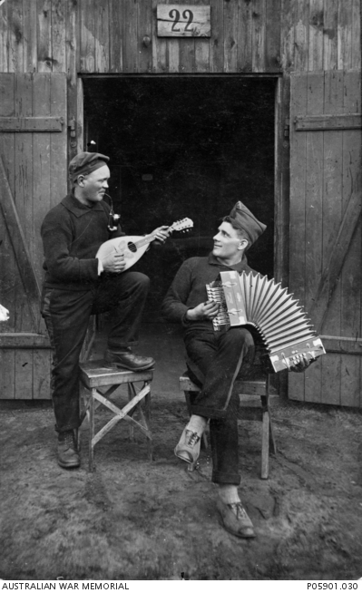 Allied prisoners of war playing musical instruments at a German POW camp